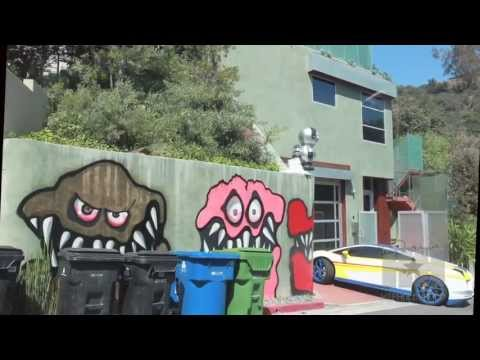 hiphollywood.com - Brown recently spray painted the side of his Hollywood Hills home with colorful, sharp tooth goblins and monsters, which neighbors are calling the