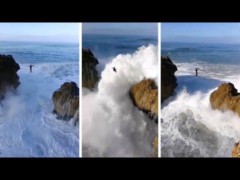 العرب اليوم - شاهد: موجة عملاقة تصيب متهور يسير أعلى حبل