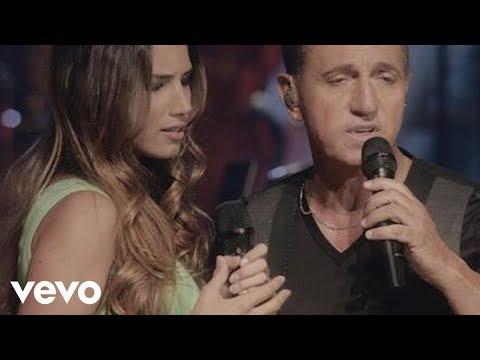 Tekst piosenki India Martínez - Cuando Tus Ojos Me Miran (con Franco de Vita) po polsku
