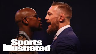 UFC welterweight champion and Fox UFC analyst Tyron Woodley gives his thoughts on Conor McGregor's upcoming fight against Floyd Mayweather.Subscribe to ►► http://po.st/SubscribeSIFollow the latest NFL news and highlights, with updates on your favorite team and players. Want to know what's up with Russell Wilson, Cam Newton, Tom Brady and more? We've got you covered:http://po.st/PlaylistSI-NFLCan the Cleveland Cavaliers repeat? Will the Golden State Warriors make history again? Keep up with all the important NBA updates, including news on LeBron James, Kevin Durant, Steph Curry and more:http://po.st/PlaylistSI-NBAFrom Bryce Harper and Mike Trout to Clayton Kershaw and Madison Bumgarner, Sports Illustrated brings you the smartest commentary and inside stories on the latest MLB news:http://po.st/PlaylistSI-MLBCheck out the most recent clips and highlights from episodes of SI Now, Sports Illustrated's daily talk show. From interviews with the biggest newsmakers to discussions with our award winning writers and editors, SI Now is your spot for all things  football, basketball, baseball and everywhere else around the world of sports:http://po.st/PlaylistSI-NowThe best of SI's award-winning video storytelling. From household names to the lesser known, SI Films' features and series explore the most powerful stories in sports:http://po.st/PlaylistSI-FilmsCONNECT WITH Website: http://www.si.comFacebook: http://po.st/FacebookSITwitter: http://po.st/TwitterSIGoogle+: http://po.st/GoogleSIInstagram: http://po.st/InstagramSIMagazine: http://po.st/MagazineSIABOUT SPORTS ILLUSTRATEDSports Illustrated offers sports fans trusted, authentic, agenda-free reporting and storytelling featuring sports news, scores, photos, columns and expert analysis from the latest in today's world of sports including NFL, NBA, NHL, MLB, NASCAR, college basketball, college football, golf, soccer, tennis, and fantasy.Tyron Woodley On McGregor Vs. Mayweather, Who Will Land A Punch  SI NOW  Sports Illustrate