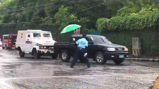 RAIN OR SHINE: Despite the rain, a Bacolod City Traffic Discipline Officer still manages to perform its duty by directing traffic along Lacson and Lizares Streets.
