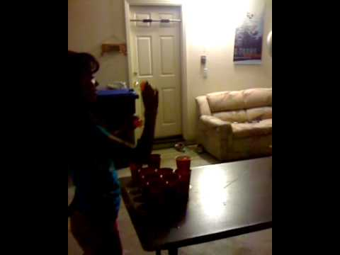Kids playing Beer Pong..