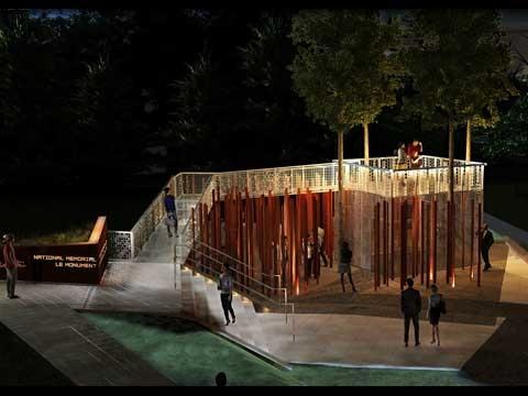 Monument vu de haut, montrant une rampe qui mène à une plateforme d'observation entourée de colonnes de bronze élancées.