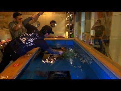 New Yorker Restaurant: Fisch fangen, in der Küche abg ...