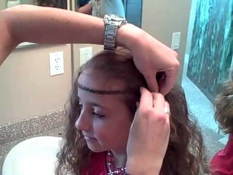 This is a fun and very simple teen hairstyle that uses a very simple braid in a very unique way. The rest of the hair was a 'second-day' hairdo after taking