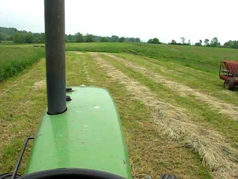4430 - mowing some hay down with the John Deere and the 411 New Holland discbine.