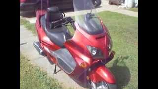 2. 2002 Honda Reflex NSS250