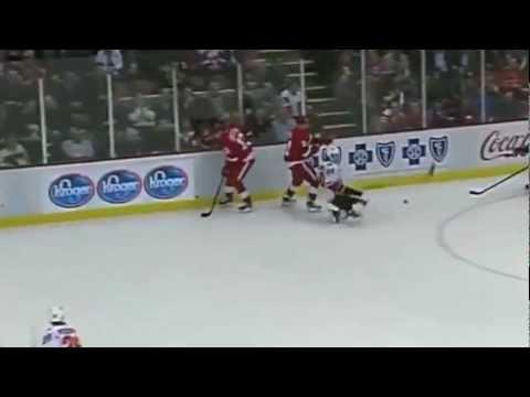 Tomas Tatar hits Curtis Glencross (видео)