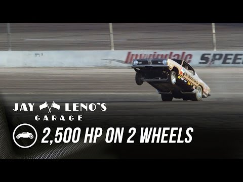 Jay Leno went for a ride in a 2500HP wheelie car and it flipped.