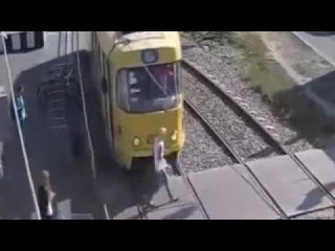 Video Warning, graphic video: Woman hit by train, loses leg download in MP3, 3GP, MP4, WEBM, AVI, FLV January 2017