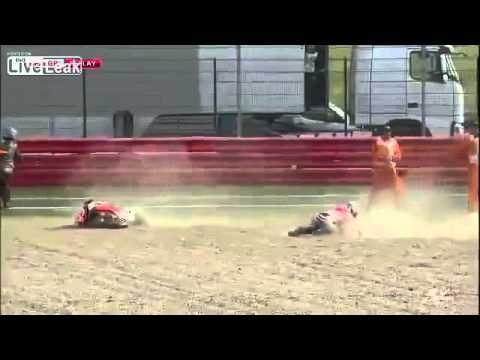 Marshall's were almost hit after Crutchlow and Marquez crash! Hertz British GP 2013