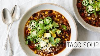 This veggie-packed taco soup recipe only takes 30 minutes to make and tastes amazing. With ground beef, onion, bell pepper,...