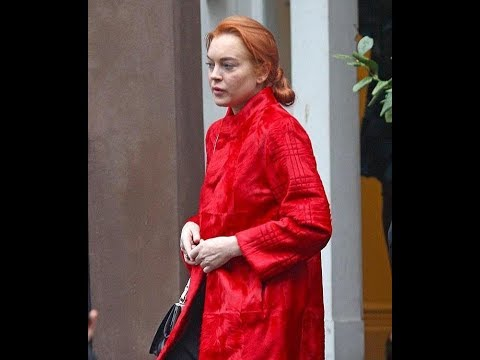 Lindsay Lohan steps out wearing a loud red jacket