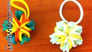 Fleur 5 pétales en élastique Rainbow Loom Dans notre canal général vous pourrez trouver tout ce que vous pouvez imaginer faire et apprendre. Sur ToutComment....