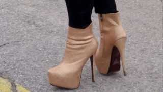 Gina White Walking In High Heels Platform Golden Designer Boots