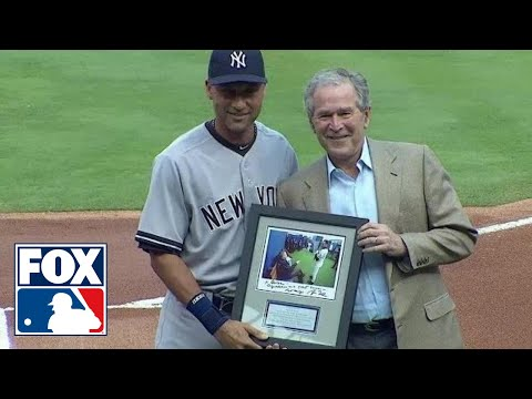 Bush - Former President George W. Bush presents Derek Jeter with a signed photo during the Texas Rangers' farewell ceremony.