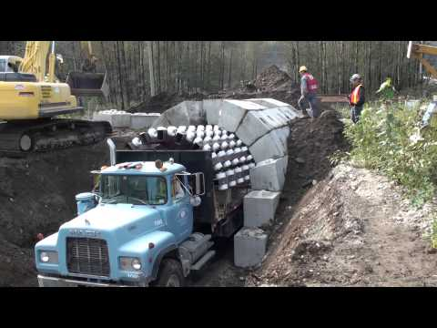 tunnel - This video shows the versatility of the Zipper truck system. We are able to create tunnels with openings very quickly with no permanent support work. This ar...