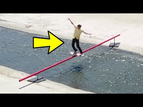 SKATING A 28 FT RAIL OVER THE LA RIVER (видео)