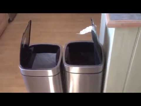 Guy laughs at automatic garbage bins