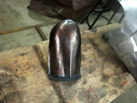 removing mill scale and heat coloring steel