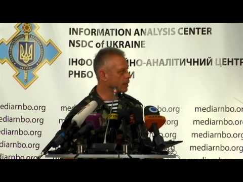 center - Col. Andriy Lysenko, Ukrainian National Security and Defense Council information center spokesman.