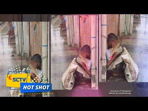 Viral! Akbar, Bocah Pemulung Membaca Al-Qur'an di Tengah Guyuran Hujan - Hot Shot