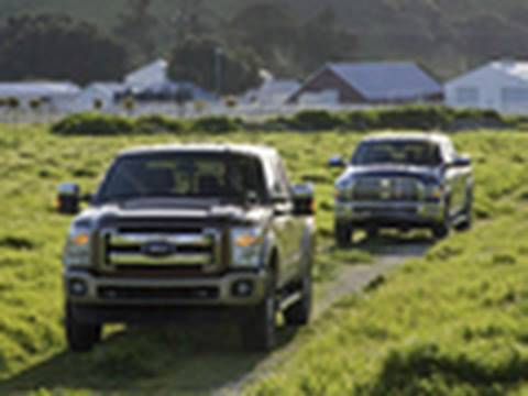 Ford - We pit the all new 2011 Ford Super Duty against our reigning Truck of the Year, the 2010 Ram Heavy Duty to figure out which one is truly the king of the heav...
