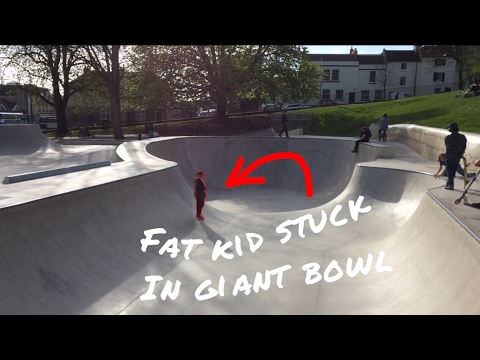 Fat kid stuck in giant bowl