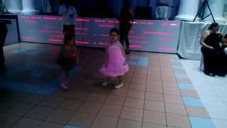 Little girl dancing very funny at a Greek wedding
