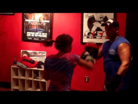 SSF Submission Academy - 12 year old Emma working the mitts with Coach Darryl Tomlin.