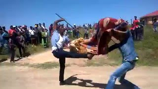 http://XhosaCulture.co.za Stick fighting is a sport played by many people of Nguni and Sotho origin in Southern Africa. Here it is played by men on their way back ...