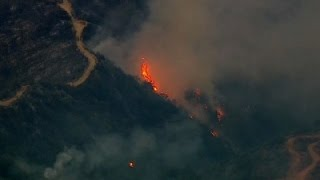 Hundreds of new evacuations across West as wildfires surge