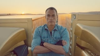 Watch Jean-Claude Van Damme carry out his famous split between two reversing trucks. Never done before, JCVD says it's the ...