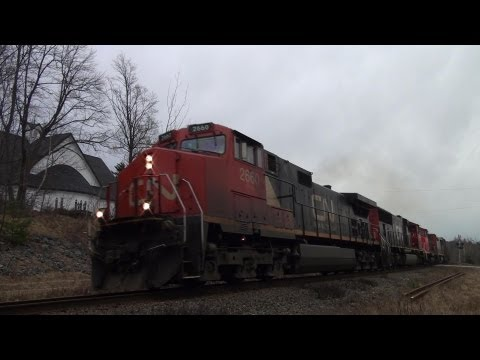 2660 - CN 2660 leads the daily eastbound freight (A406) through Rothesay, NB. CN 2660 leads CN 5756, CN 9416 and CN 2431, a nice 4-unit lashup. Taken at mile 78 of ...