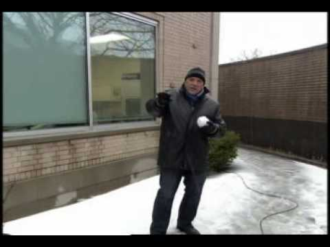 TV Reporter Nails Stagehand with Snowball Video