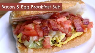 "Join Amy as she makes the BEST breakfast sandwich: a Bacon and Egg Breakfast Sub. This starts with a sub or hoagie roll and then Amy cooks up some onion, garlic, Anaheim peppers, scrambled eggs, bacon, tomato, and cheese. The scrambled eggs uses Amy's Perfect Fluffy Scrambled Eggs technique to make the BEST scrambled eggs that you have ever tasted. They are very tasty! This is the perfect breakfast recipe!!Global Knife:http://amzn.to/2fuUuqrAll-Clad Griddle:http://amzn.to/2vGMTMdAmy's Perfect Fluffy Scrambled Eggs:https://youtu.be/Vuy2nrJz0ZwAmy Learns to Cook is all about learning to make simple, tasty food from fresh ingredients.  One year ago, I made a commitment to stop eating processed convenience foods.  I decided to learn to cook ""real"" food. Join me!  Let's learn to cook together! Enjoy! Please share! Please SUBSCRIBE to my channel, LIKE, and leave a COMMENT.Please visit my website: www.amylearnstocook.comAny links in this description, including Amazon, are affiliate links."