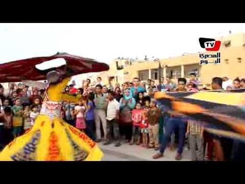رقص وتنورة ومزمار على كورنيش الإسكندرية