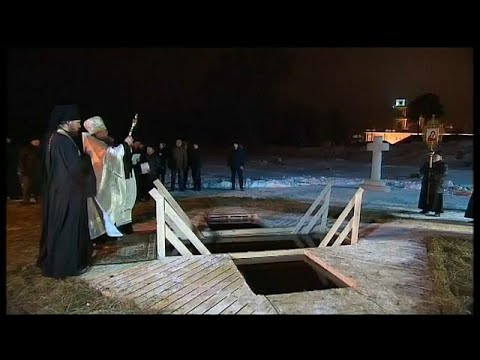 President Vladimir Putin takes below-freezing Epiphany dip