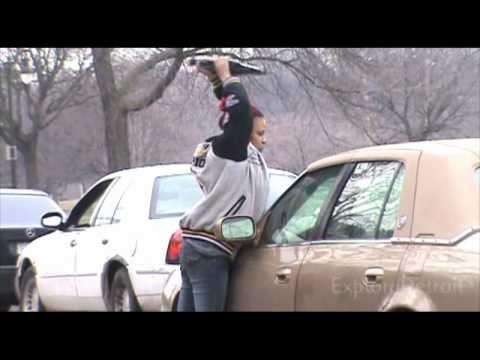 | Hood Chick Breaks Boyfriends Brown Cadillac Windows after police left |