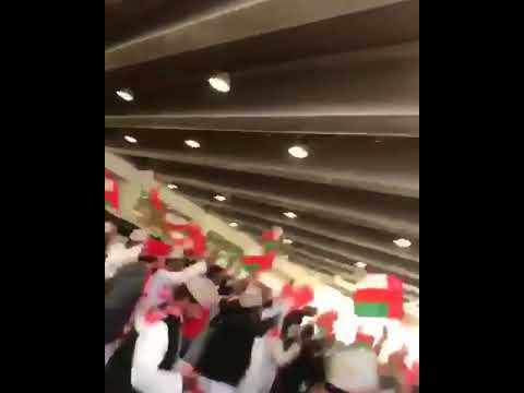 Enthusiastically waving flags and scarves and loudly singing football chants in support of their team, the Oman contingent have now boarded buses that will take them to the Jaber Al Ahmad International Stadium, where the match is being played this evening.
