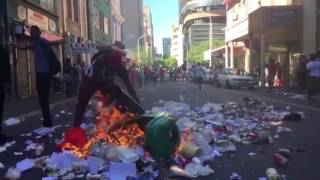 Today #FeesMustFall protesters descended on the Cape Town CBD smashing windows, setting bins alight causing overall chaos whilst on their way to Parliament.