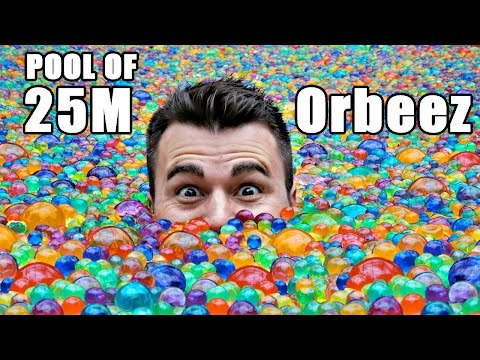 Swimming  In A Pool Of Tiny Orbeez Water