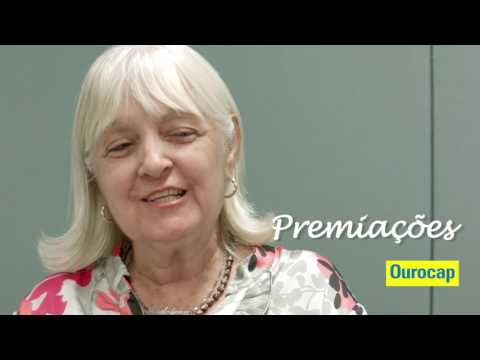 <span class=depoimento_nome><strong>Histórias Inesquecíveis - Maria Madalena e Paulo Fiuza</strong></span><br /><br /><span class=depoimento_aspas></span><span class=depoimento_descricao>A Maria Madalena fez o Ourocap para juntar dinheiro. Sempre que uma vigência acaba, ela corre para fazer outro plano. Neste ano, ela e seu marido foram sorteados.  </span><span class=depoimento_aspas></span>