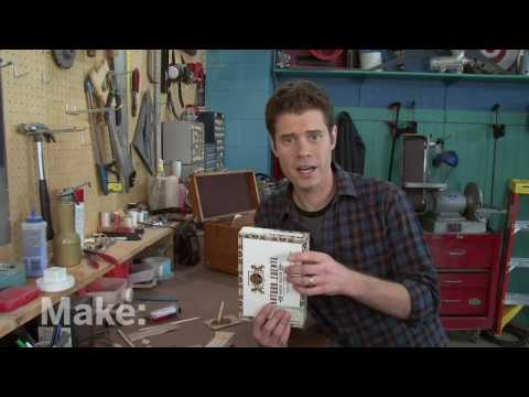 Make: television - With a piece of oak, some string and a cigar box, John Park creates a three-stringed guitar. The cigar box acts as the resonating soundboard for the instrume...
