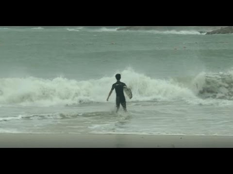Surfers in Hong Kong take to the sea despite warnings and a city-wide shut down of transport and businesses due to Typhoon Haima.