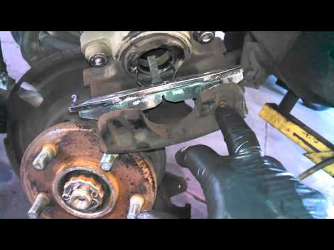 Front brake pad replacement 1993-1998 Jeep Cherokee Wrangler pads Install Remove Replace How to
