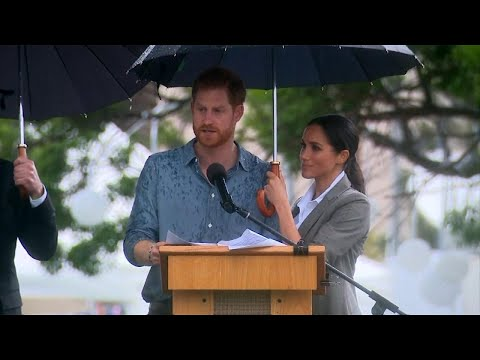 Meghan Markle Keeps Prince Harry Dry by Holding Umbrella for Him