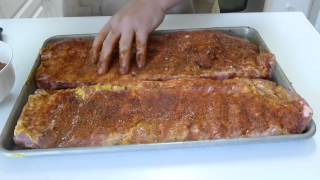 Making great pork ribs using a dry rub. Removing the membrane. Oven baked and finished on the grill. The drippings make great beans.