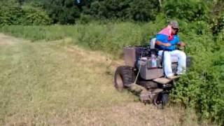 Dixie Chopper XD5000 50hp Yanmar Diesel attacks 4' high brush & thick matted bahia grass. Two passes is all that is required to...