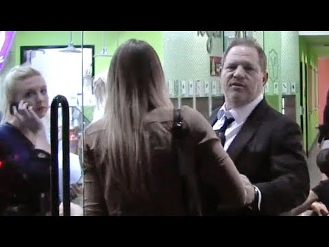 Harvey Weinstein Gets Peeved At Paparazzo For Filming Him With Two Young Women [2014]